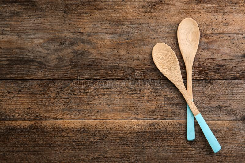 Clean empty bamboo spoons on wooden background, top view. Space. For text royalty free stock image