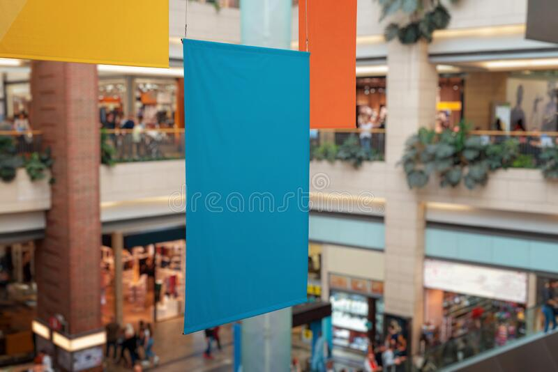 Clean, empty banners hanged inside the shopping mall. Brand promotion, mockup stock image