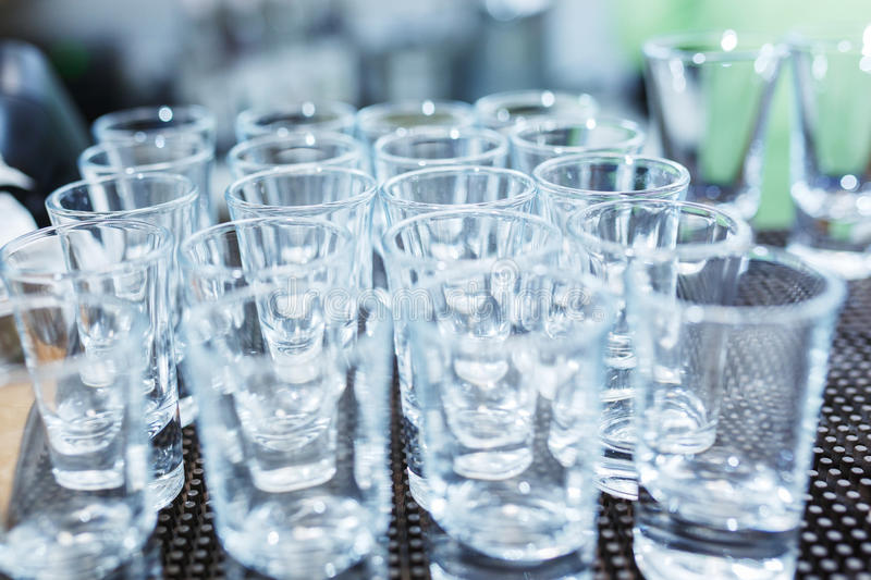 Download Clean Empty Glasses For Strong Alcohol On The Bar During The Event. Stock Image - Image: 83710795