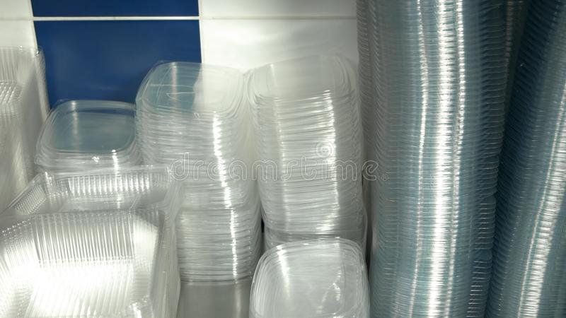 Clean empty plastic boxes close up. Many transparent containers for food packaging stock images