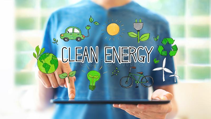 Clean energy concept with man using a tablet stock photography