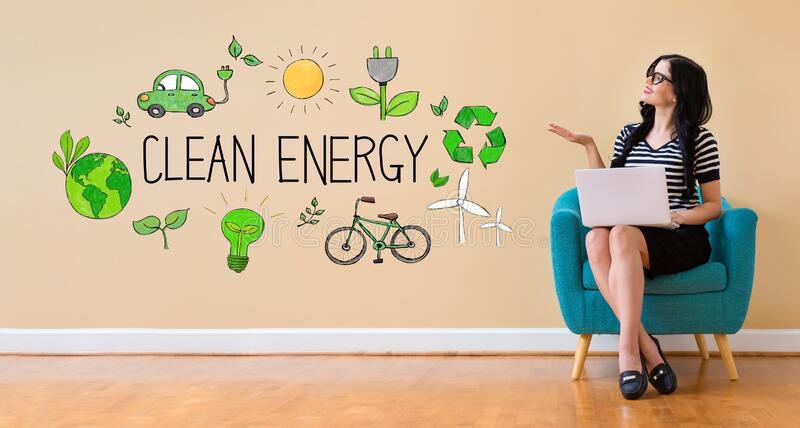 Clean energy concept with woman using a laptop royalty free stock photos
