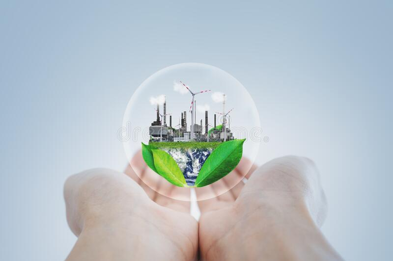 Clean energy, eco-friendly industrial and wind power power plants concepts. Element of this image are furnished by NASA. Clean energy, eco-friendly industrial royalty free stock photography