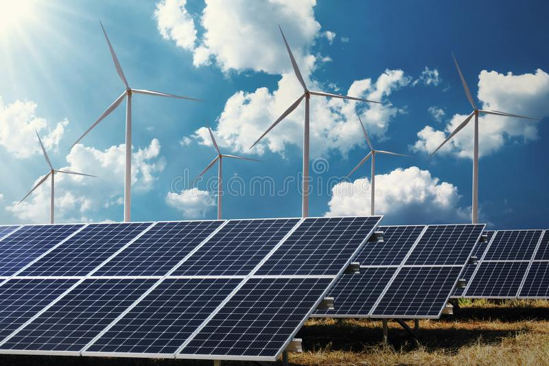 clean energy power concept solar panel with wind turbine and blue sky royalty free stock photography