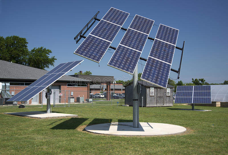 Clean Energy Solar Power Panel Arrays and Blue Sky with Green Grass stock photography