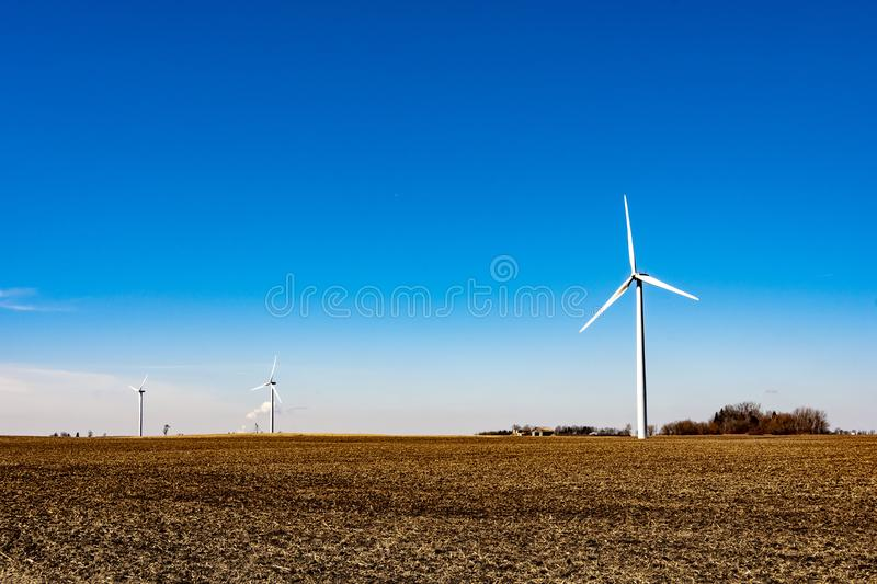 Clean energy - wind turbines. Shot of multiple wind turbines in a green, clean energy power plant stock image