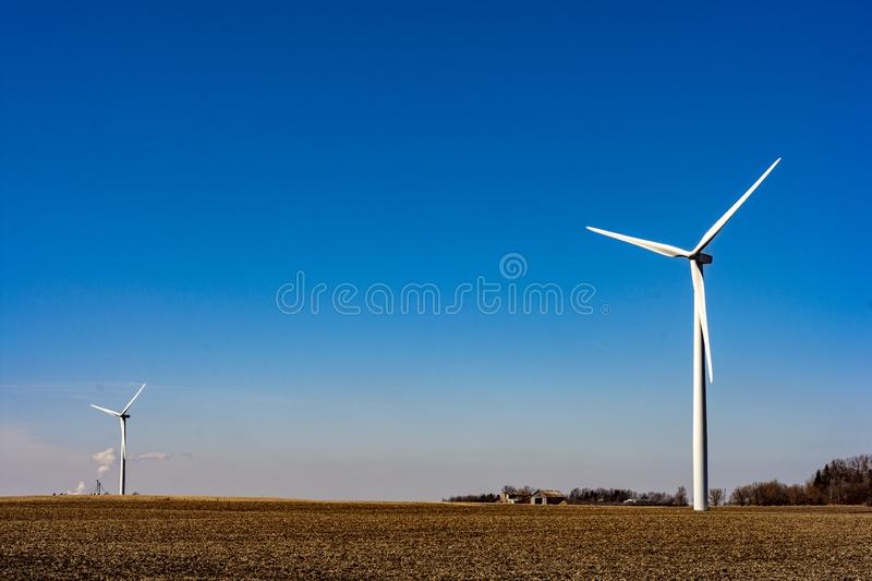 Clean energy - wind turbines. Shot of multiple wind turbines in a green, clean energy power plant royalty free stock image