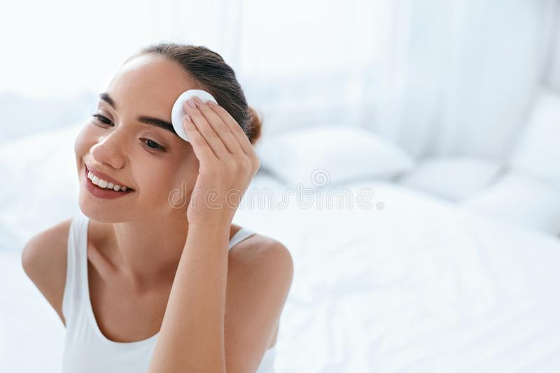 Clean Face. Beautiful Woman Cleaning Skin With Cosmetic Pad stock photography