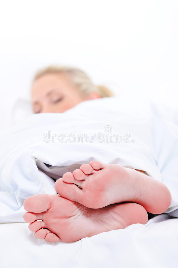 Clean feets of  woman sleeping cover  blanket