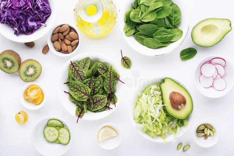 Clean food. Fresh raw vegetables and lettuce leaves to prepare a healthy snack meal salad. Top view. On a light stock photography