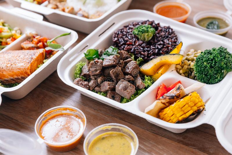 Clean food meal box: Diced grilled beef served with rice berry, broccoli, bean sprout, corn, mushroom and tomato.  stock photography