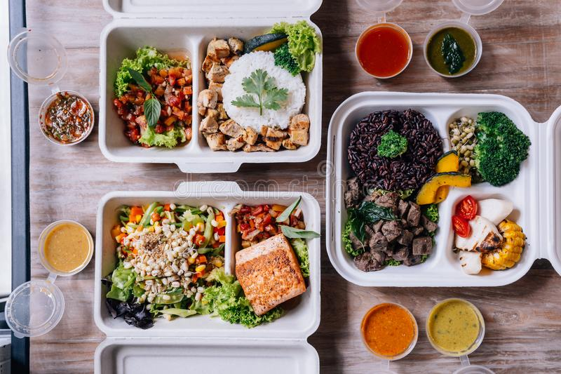 Clean food meal boxes: rice and rice berry with beef, salmon and chicken in various vegetables and salad for good health.  royalty free stock photo