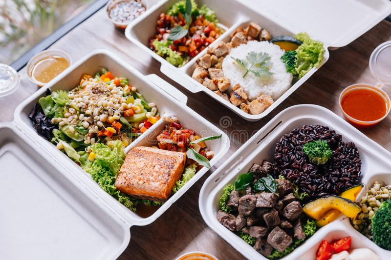 Clean food meal boxes: rice and rice berry with beef, salmon and chicken in various vegetables and salad for good health.  stock image