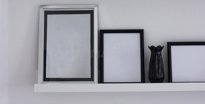 Clean frames for text, details of the modern interior, banner. The Clean frames for text with vase on shelf, details of the modern interior stock photography