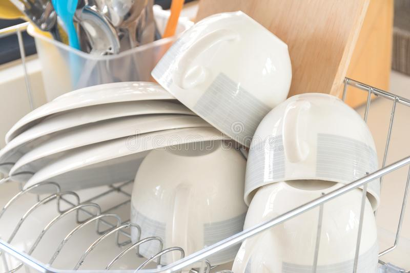 Clean glasses and cups in the basket stock image