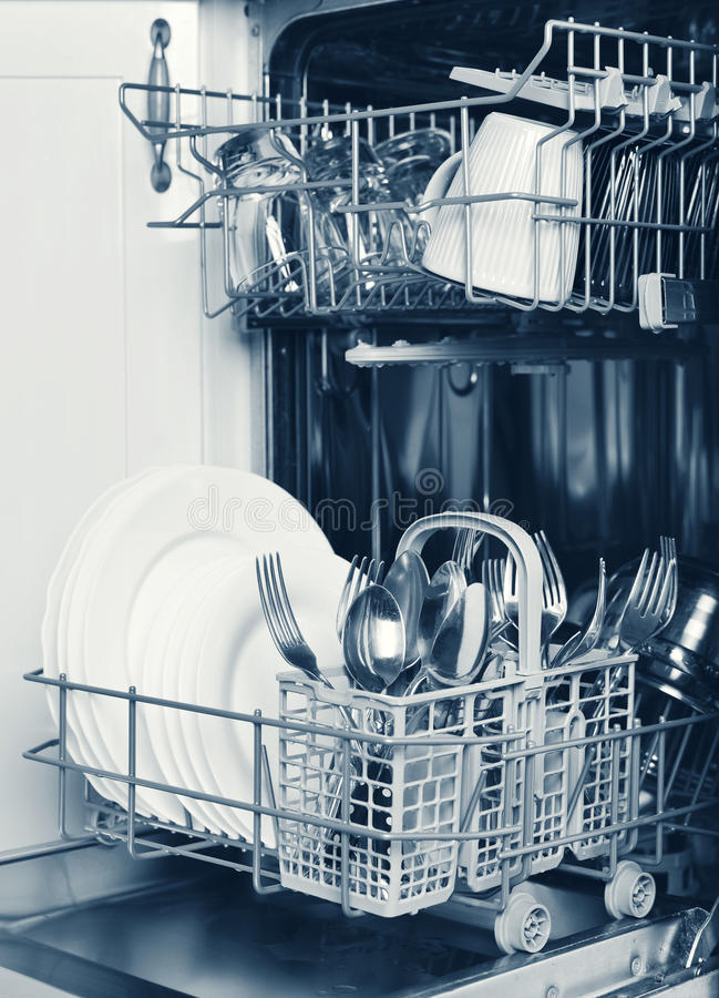 Clean glasses, cups,cutlery and plates stock photography