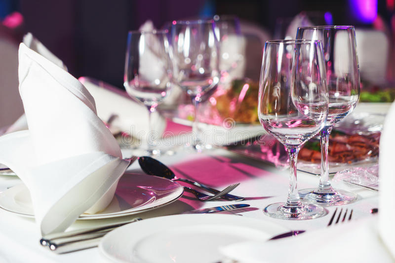 Clean glasses on a table prepared by the bartender for champagne and wine. Clean glasses on a table prepared by the waiter for champagne and wine. Several of royalty free stock image