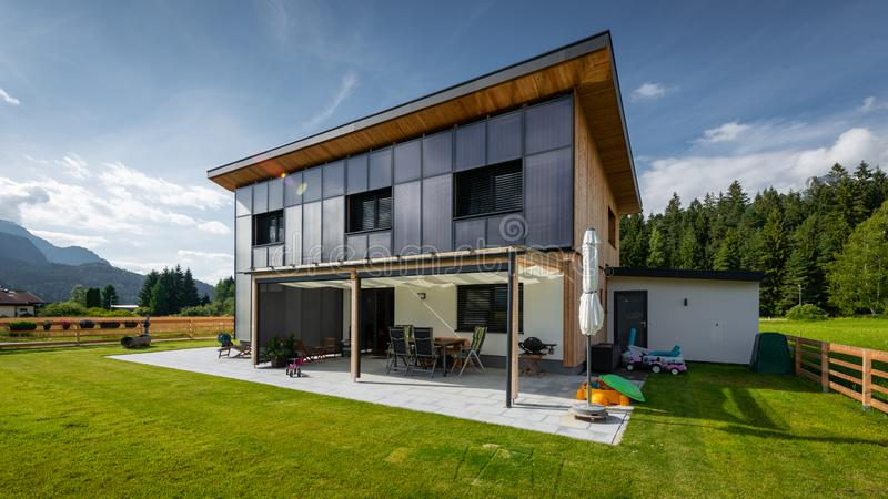 Perspective of sun energy solar sun house with panels on front. Clean green energy efficient saving source solar house on residential house front for free royalty free stock photo