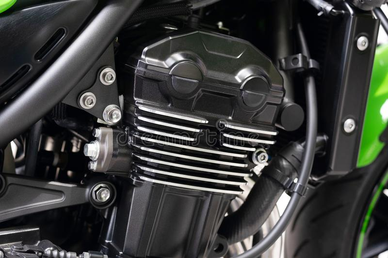 Clean inline Four Motorcycle Engine, Big Street Cafe Bike with Full Horsepower.  stock images