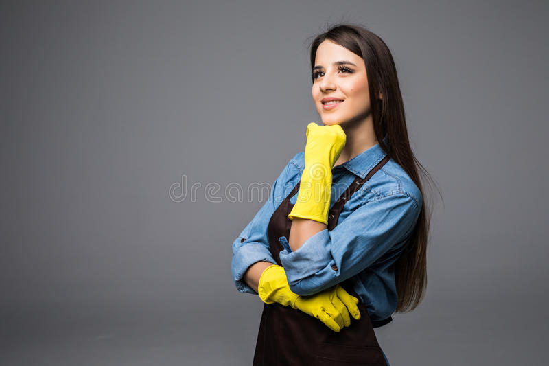 Clean lady thinking idea and holding chin isolated. On grey background royalty free stock photo
