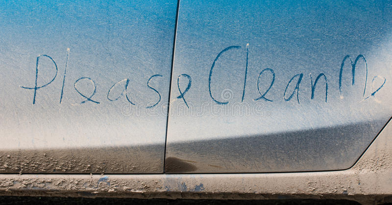 Clean me written on car stock photography