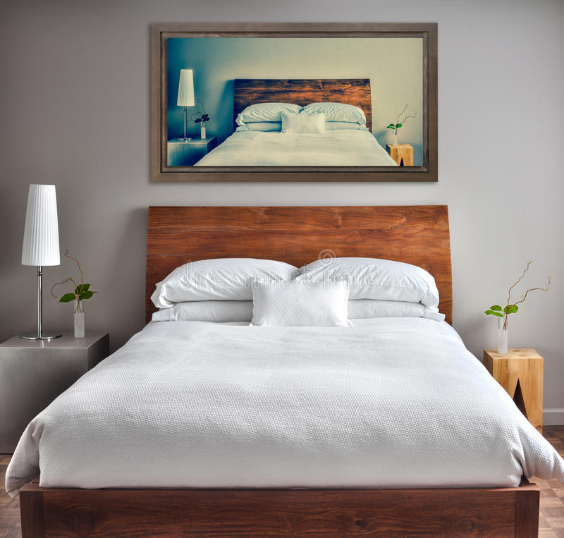 Clean and Modern Bedroom with fun Canvas on the Wall royalty free stock photography
