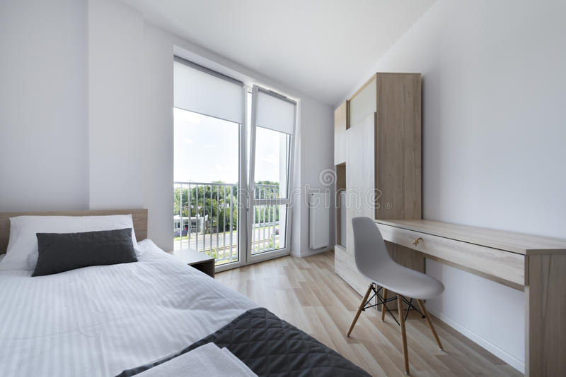 Clean and Modern Bedroom in scandinavian style royalty free stock photo