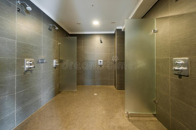 Clean and modern shower room in fitness studio royalty free stock photography