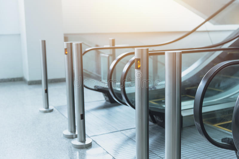 Clean new escalator interior in modern office building stock photography