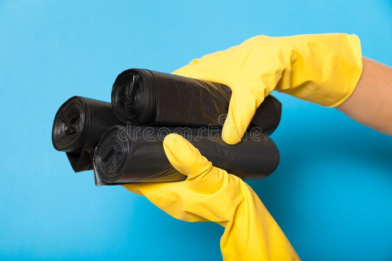 Clean new garbage bag, black bin container.  stock photo