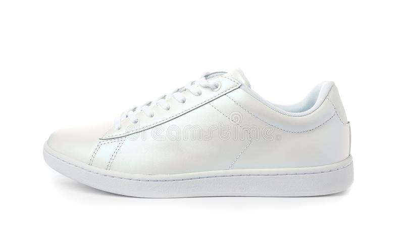 Clean new trendy sneaker. On white background royalty free stock photo