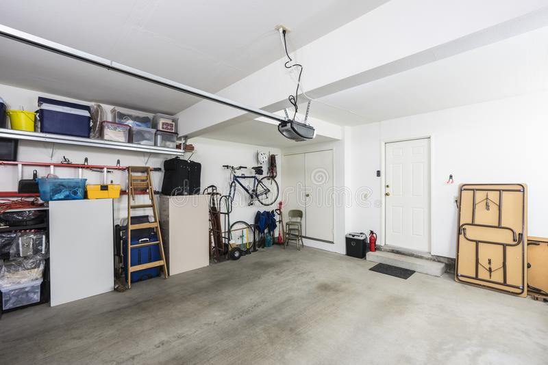 Organized Suburban Garage. Clean organized suburban residential two car garage with tools, file cabinets and sports equipment royalty free stock images