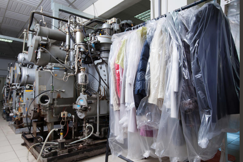 Clean packed clothes hanging in dry cleaning. Image of clean packed clothes hanging in dry cleaning stock photo