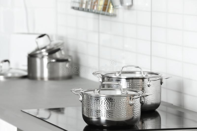 Clean pans on stove in kitchen. Space for text stock images
