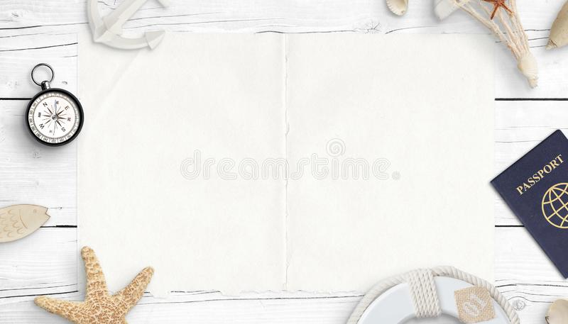 Clean paper surrounded by passport, compass and sea things. The concept of planning travel and vacation at sea. Copy space, flat lay, top view royalty free stock photos