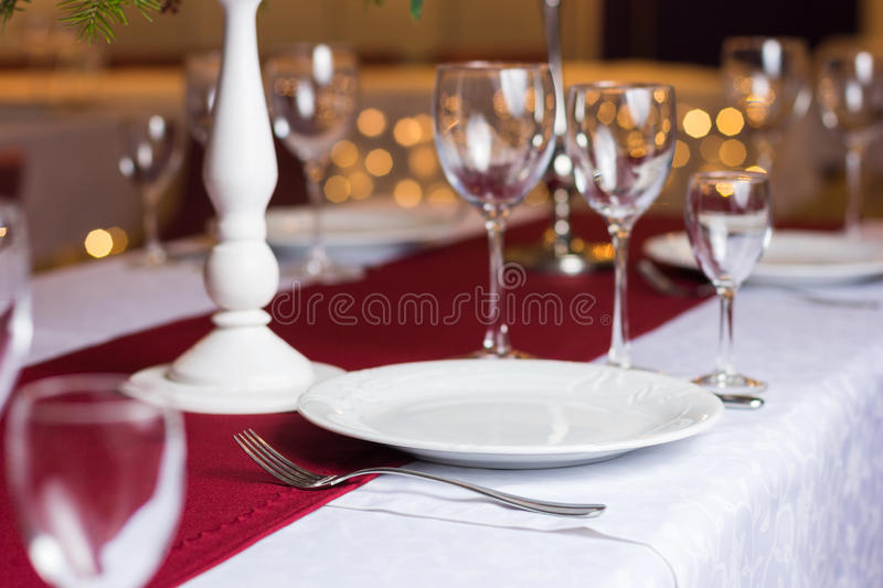 Clean plate on table in restaurant stock photography