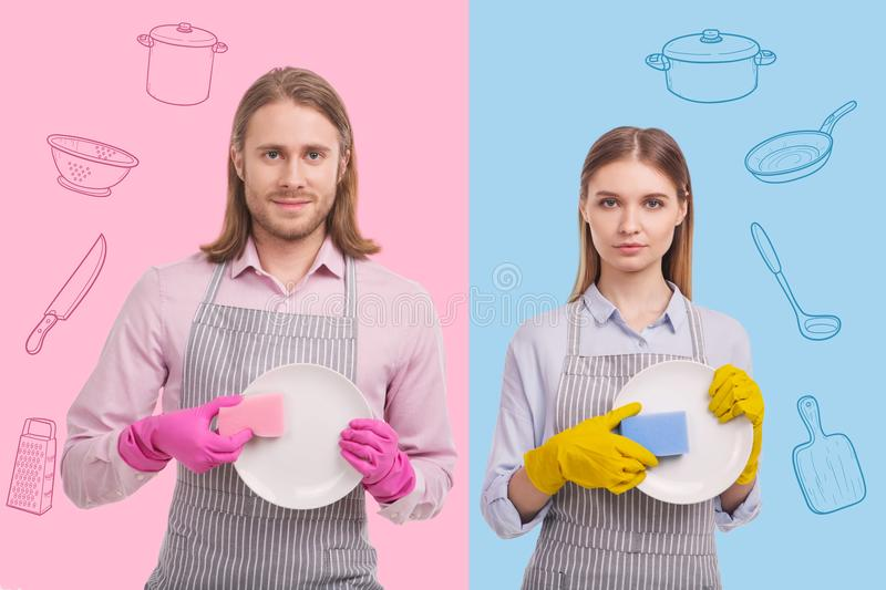 Calm kitchen workers showing clean plates and looking confident stock photography