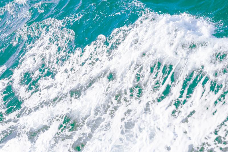 Clean pure Mediterranean sea surface with a lot of tiny waves, bubbles and foam. Copy space background royalty free stock images