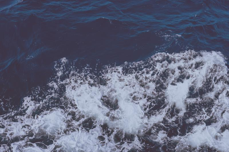Clean pure Mediterranean sea surface with a lot of tiny waves, bubbles and foam in vintage colors tones. Copy space background royalty free stock photos