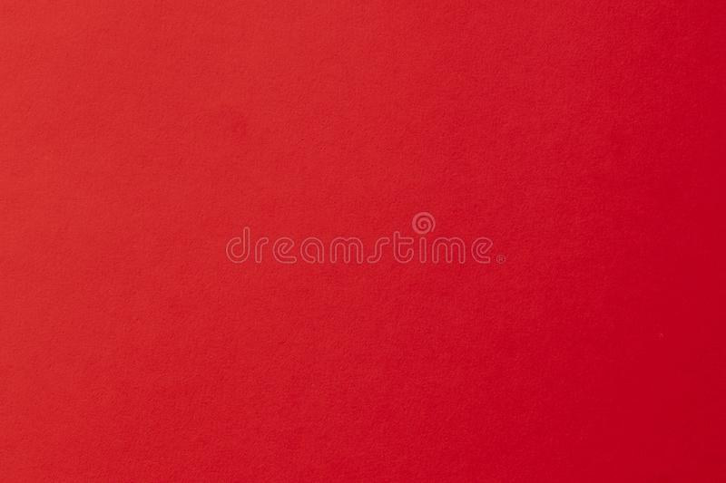 Clean red paper texture with simple surface. High resolution. Color flame red paper. Empty bright red paper backgrounds stock photography