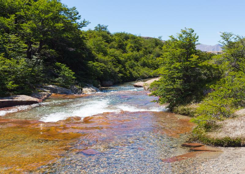 Clean river formed by melting snow and ice, Argentina royalty free stock photography
