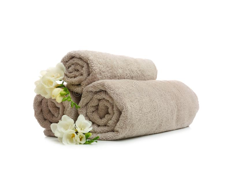 Clean rolled towels with flowers. On white background stock image