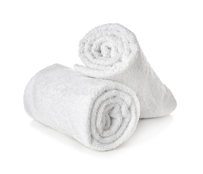 Clean rolled towels on white background stock photos