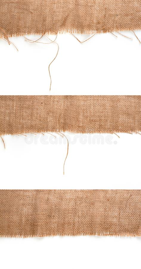 Clean sackcloth fabric worn edges, detail closeup on white background royalty free stock photo
