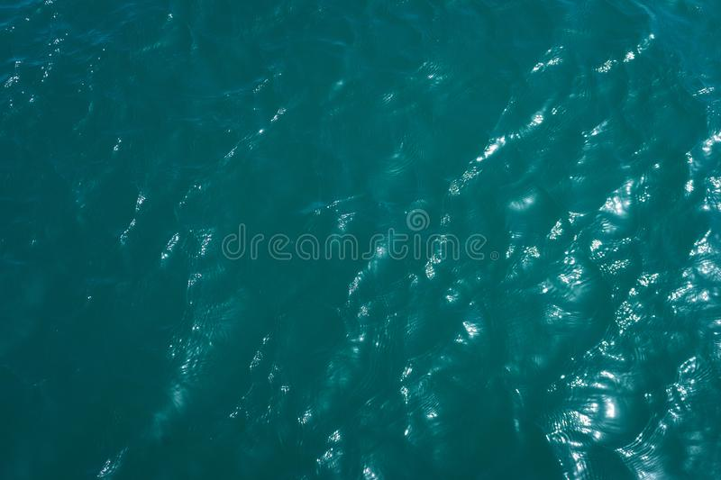 Abstract background of water surface. Clean sea surface with small waves. Beautiful color and refreshing coolness. Abstract background of water surface stock photo