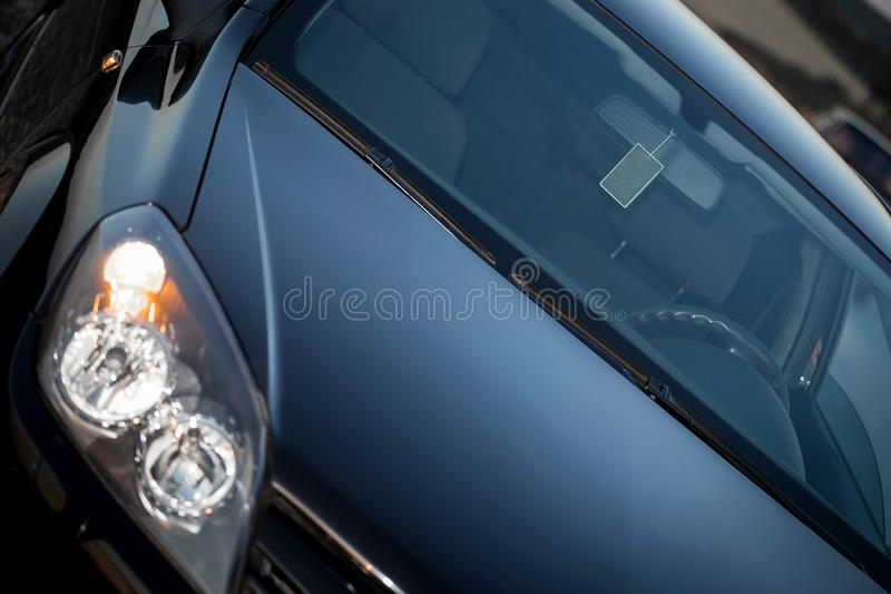 Clean shiny front section of a modern black car royalty free stock images