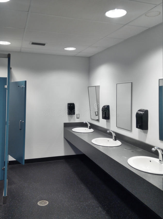 Clean simple public washroom sinks toilet stalls stock photos