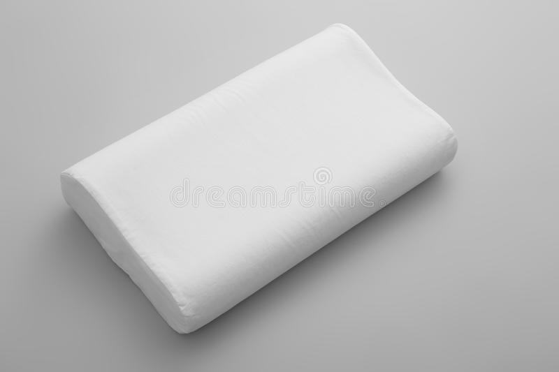Clean soft orthopedic pillow. On grey background stock image