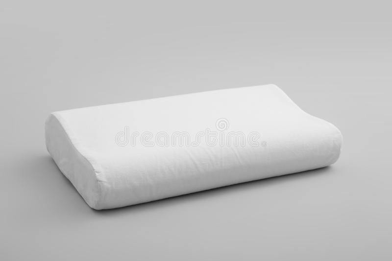 Clean soft orthopedic pillow. On grey background royalty free stock photography