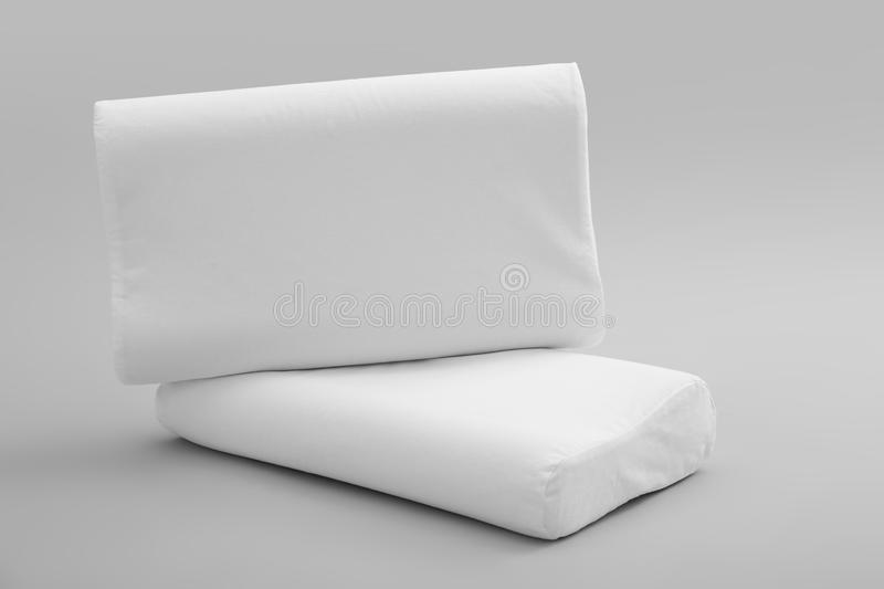 Clean soft orthopedic pillows. On grey background royalty free stock image